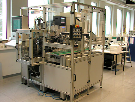 Punching and welding automat for satellite solar cells